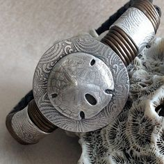 Silver Sand Dollar and Leather Bracelet by LindaMackSilver on Etsy