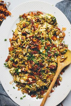 A warm side dish perfect for fall or winter. Brussels sprouts, pecans, and coconut bacon are tossed in a tangy mustard dressing! 30 minutes and 100% vegan.
