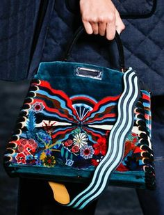 dafd4c061de9 I m with the band Guitar straps moonlighted as bag handles at Fendi and  Burberry