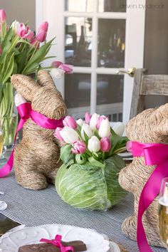 Darling idea for an Easter table centerpiece! Hollow out a cabbage to fit a small glass vase and fill with tulips! Then just two decorative bunnies on each side (these cuties are from HomeGoods)! (sponsored pin)