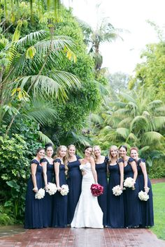bride with bold bouquet - bridesmaids with light