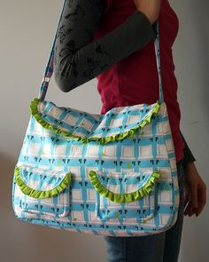 For an ''intermediate'' at least...From Sew Sweetness, a Tutorial for the frou frou bag shown.  Be sure to either print out or download the pattern (from a link in tute) ~ I can see this in so many print combinations ~ Sew Cute!  Here ~ http://www.sewsweetness.com/2012/01/frou-frou-bag.html