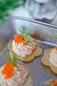 Smoked Salmon Mousse on Filo Crackers, with a playful pop of flying fish roe, bite-sized appetizers sure to please!