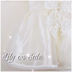 Shop Lily 'Ivory' Dress today! Available sizes from 12m to 7y. Hurry while stocks last!