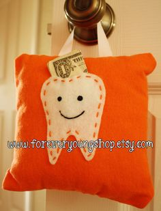 Orange Tooth Fairy Pillow - hello, love this!  Getting one for the bed post.