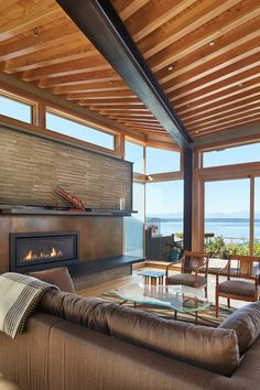"stylish-homes: "" Living room features a high ceiling and lots of glass to take advantage of this home's views of Puget Sound and the Olympic Mountains. """