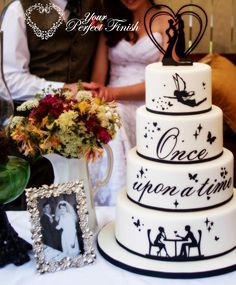 A beautiful silhouette wedding cake with the perfect cake topper.  Black and white wedding theme