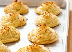 Duchess potatoes are an elegant, French-pedigreed classic in which mashed potatoes are enriched with egg, piped into decorative rosettes, and baked until golden brown. The egg lightens the potato, creating an almost weightless, dainty fluff that contrasts with the crispy, craggy exterior. In 1867, an article in Galaxy magazine lamenting the state of American cooking noted duchess potatoes on the menu of a rare good dinner. For the next century, the dish made regular appearances on the menus…