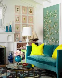 small living room with tall artwork and turquoise couch