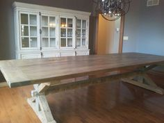 Trestle base reclaimed wood dining table