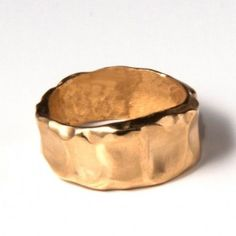 Butter, 9k Gold Unisex Wedding Ring -- love the unusual hand-made look to it