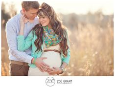 maternity portraits... Love the pop of color in her scarf and cardigan