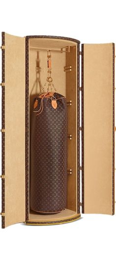 Louis Vuitton punching bag by Karl Lagerfeld. Now ladies you can take your kick-boxing workout with you where ever you go.
