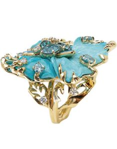 Dior Joaillerie ring   yellow gold, diamonds, boulder opals, and turquoise.