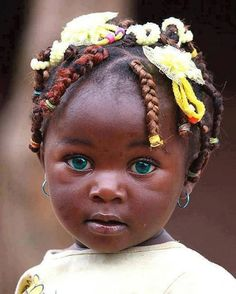 The beautiful dark skin and the very blue eyes .... what a gorgeous little one she is.