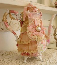 teapot in pink and lace