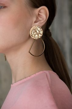 The Ebi in Black, a pair of delicately a gold vermeil attached to gold hoops. Post back. Sold as a set.