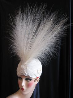 Lanvin hat,  teens or 1920s. This hat is expertly crafted of ivory colored silk cording which has been hand fastened to a net cap. A matching thick, ivory silk cord braid finishes the brim. The extremely long and delicate matching ivory colored feathers add all the drama that makes this hat so unbelievably special.