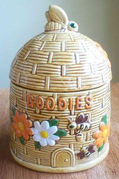 Vintage ceramic bee hive flowers and bees cookie jar.  via Etsy.