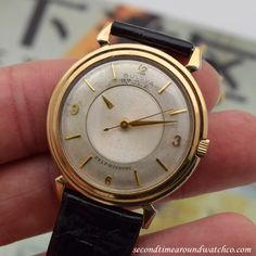 A 1950's era Bulova Mystery Dial 10K yellow gold filled watch that features an original, patinated silver dial with applied, yellow gold Arabic numerals and bar markers, and a floating, beveled, hour hand. This example also comes equipped with a...