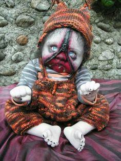 So creepy cute! Zipped faced zombie reborn