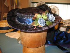 1860's Summer Hat for Lee, entirely hand-made by Meg. We're trying spray-varnish on the buckram to see if it holds up better to the weather.