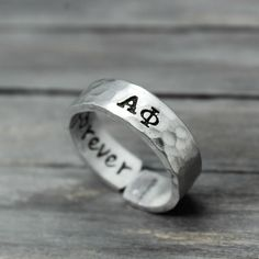 This custom Alpha Phi sorority ring is the perfect way to show of your letters. Features & Measurements: ♥ 14 Gauge Hammered Aluminum ♥ Infinity Heart Stamp ♥ Stamped Inside With 'forever'