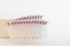 Amazon Barnes & Noble Indiebound.org Purl Soho Watch The Trailer I first made these combs with rhinestone trim. They are beautiful, you can see photos below, but it is amazing how difficult it is to photograph rhinestones well enough to catch the twinkle. I thought I'd try the pearls for the tutorial and I love …