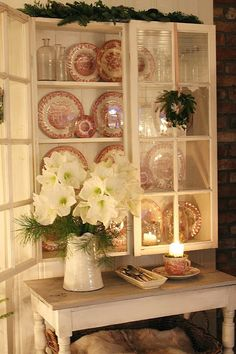 Red and white transferware in cabinet with glass doors -- VIBEKE DESIGN