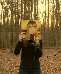 PIC: Joni Mitchell / people do this a lot now 2015, this DOES happen to look like Joni's right hand .... and she IS holding the right kind of flower --- makes me wonder if she didn't do it on a goof. The lighting is so good too. Wearing Black ... quite an artistic thoughtful person here ... JONI !!!!! ?