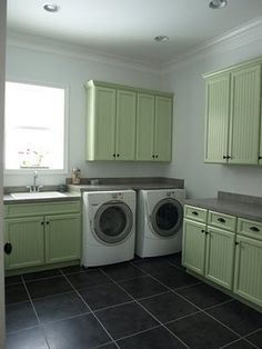 hhmmm... coloured cupboards? i like this green