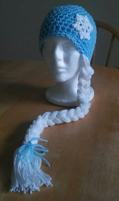 This Hat is inspired by the character Queen Elsa from the movie frozen. This hat is a toddler size (2t/3t).