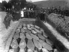 Servicemen attend the mass funeral in Cobh, Ireland, of the victims of the Lusitania disaster during 1915. The Cunard liner was torpedoed by a German submarine off the coast of Ireland and sank, killing 1,198 people aboard.