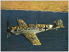 Messerschmitt BF 109E    Messerschmitt BF 109E    German fighter Messerschmitt BF 109E-7 Trop in flight. Jet Black-8 from 2./JG27 (2-27 Squadron 7th fighter squadron). Werner Schroer or Franz Elles could be at the aircraft controls.  At the tail end of an apparent four red marks on aerial victories.