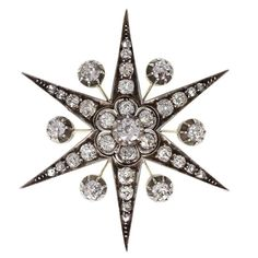 Antique Victorian Diamond Gold Starburst Brooch/Pendant | From a unique collection of vintage brooches at https://www.1stdibs.com/jewelry/brooches/brooches/