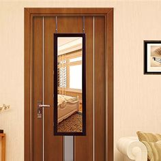 SONGMICS Lockable Jewelry Cabinet Wall Door Mounted Jewelry Armoire Organizer with Mirror LED Light, Brown