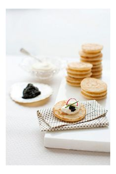 To make our event less labor intensive we bought these blinis (shhh). Then,  we set up a little make your own blini bar with caviar (we used American  Hackleback Sturgeon), creme fraiche, and garnishes of your choice--like  chives and radish for some color pop. We like this better than pre-maki