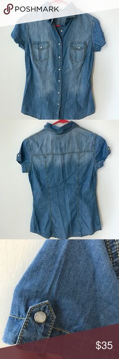 NWOT Denim button down shirt The shirt is lightweight and is more on the fitted side. It's a very comfortable piece to wear and matches with a lot of different colors Tops Button Down Shirts