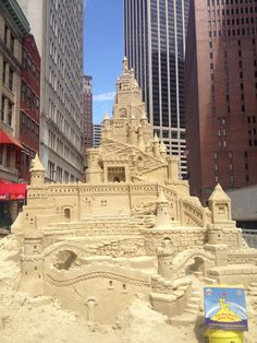 """What can we say?  Sand castles are the consummate crowd pleaser!  They inspire whimsy, fairy tales and the dream of living 'happily ever after""""!  This sand castle was created in Downtown Manhattan.  Over 50 tons of sand were used to achieve an overall height of 16 feet and incorporates every detail of castleture conceivable!  If it's crow pleasing you want, and a castle is in your plan, few create more elaborate sand castles in time allowed than Sandman Matt Long!"""