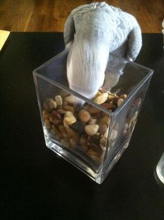 I kinda stumbled upon this idea, letting cricket run around on the coffee table. She was interested in the rocks, so I put some pellets in there. She enjoyed moving the rocks around to look for the food!