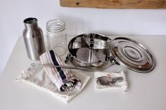 Trash is for Tossers: The Ultimate Zero Waste Lunch Kit:  1x Airtight stainless steel lunch container. Totally spill proof, easy to clean, optional dividers so that I can keep my food separate.  1x Reusable fork, fancy or second-hand. 1xReusable napkin, used for a week. 2xOrganic cotton bags for snacks(granola/nuts/popcorn) or sandwiches.  1xMason jar, glass, or stainless steel drink bottle.