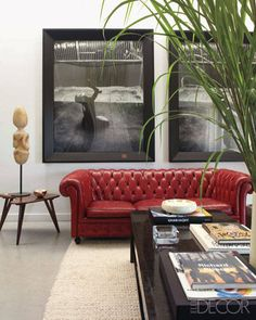 The Chesterfield sofa is upholstered in lipstick-red leather.