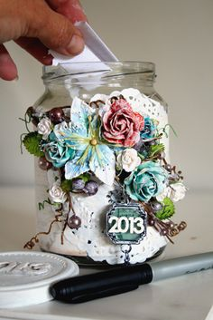 Supplies used:   844721     Tea Thyme Paper  543242    Winter Branches Grape Vine  548834    Corine Flowers  552473    Avon Rose North Country Flowers  560577    Crystals  559694    Welcome To Paris Vintage Trinkets  550073    Alphabet  Others:    Jar, Paint, Doily, Pen & Paper