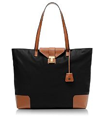 PENN TOTE. Second to the Nylon Tory Tote, this has the most space and is most durable.  I like it because it doesn't have a huge label stuck in your face.