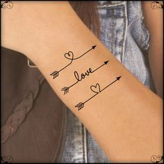 Three Arrows With Love And Heart Tattoos On Wrist