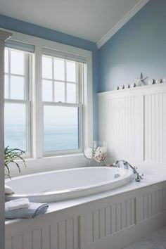 Seaside bathroom with beadboard tub enclosure