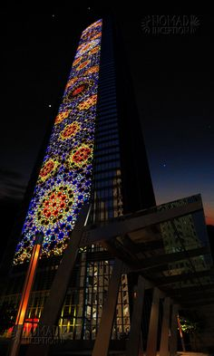 Lighting effects depicting Islamic patterns on tower façade