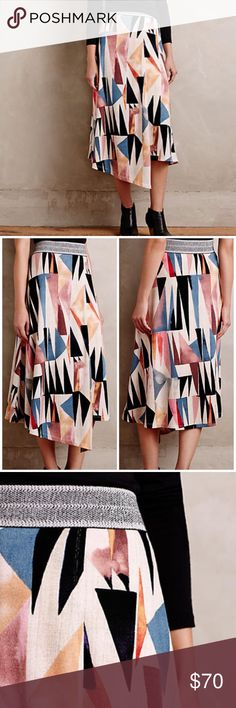 Anthropologie Marini midi skirt Great wrap-style midi skirt from Vanessa Virginia, sold at Anthropologie. Beautiful geometric design, pull on styling w an elastic band in a great silvery design. Fully lined. Super soft and comfortable. Anthropologie Skirts Midi