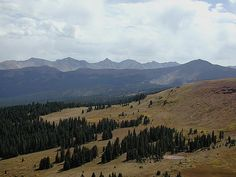 Shrine Ridge, between Copper Mountain and Vail, Colorado. The mountain ridge in the distance is the Ten Mile Range. 14,265 foot Quandary Peak is the pointed mountain near the center. In front of the Tenmile Range, slopes of Copper Mountain Resort can be seen on the left side of the darker ridge line.