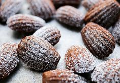 A recipe for chocolate and hazelnut madeleines, brushed with bourbon and sprinkled with powdered sugar.